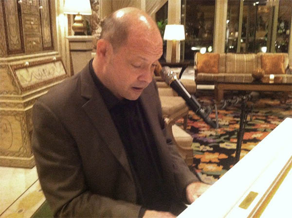 Michael Shane at the piano inside the Wynn
