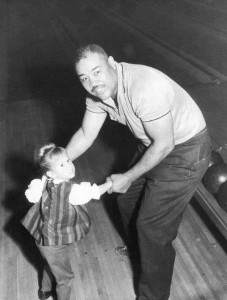 Joe Louis with Norm Johnson's daughter, Robin Johnson, at Bowling