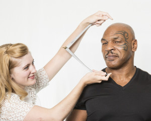 Mike Tyson getting measured for his figure.
